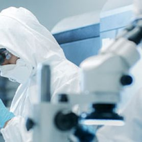 pharma researchers with microscope